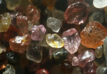 Sand from Skeleton Beach in Namibia contains rounded and polished pink-and-red garnet. Image Copyright © 2008 Dr. Gary Greenberg, All Rights Reserved.